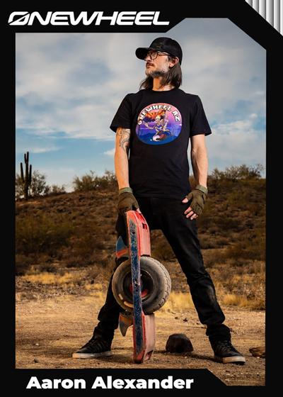 Aaron Alexander holding his Onewheel in a desert